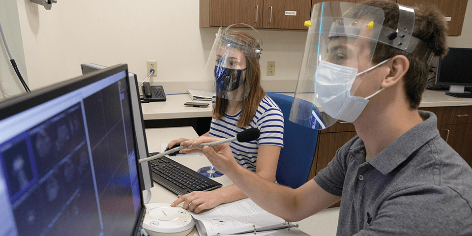 Students in the lab wearing masks