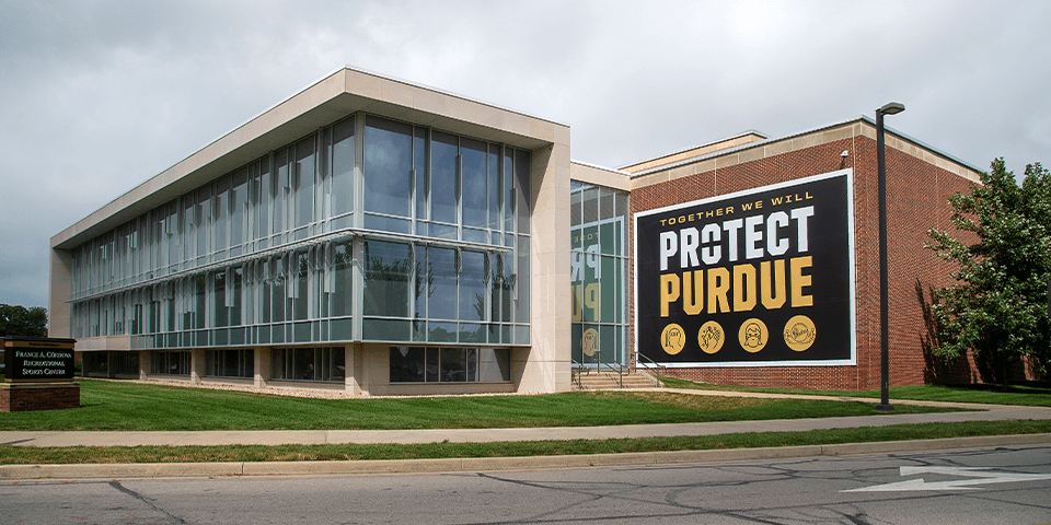 Building with protect Purdue banner